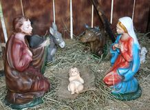 Nativity scene with statues of the Holy family praying in the ma Royalty Free Stock Photography