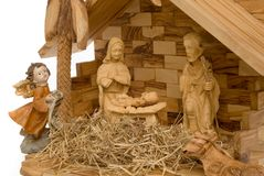 Nativity Scene, wooden figures. Nativity Scene made of wood, with white background on the left stock photo