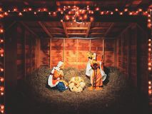 Nativity scenes exhibit figures. Representing the infant Jesus, his mother, Mary, and her husband, Joseph during the Christmas season outside a church in Stock Photo
