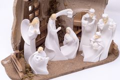 A nativity set depicting the three wise men visiting Jesus set against a clean white background royalty free stock image