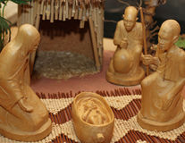 Nativity set in an village with wooden figurines 1 Stock Images