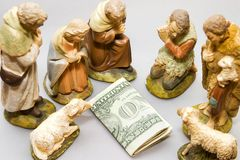 Nativity VS Commercialism. Commercialism vs Christmas, full nativity scene including money Stock Images