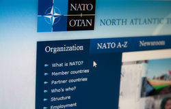 NATO. Web page with details about organization stock photos