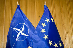 NATO and EU flags. On wooded background Stock Photos