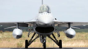 NATO F-16 fighter jet. Front view of an F-16 fighter jet on the runway stock photos