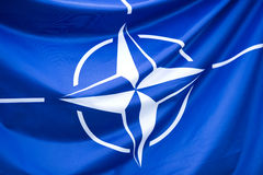 NATO Flag. Close-up photo of waving original and simple . NATO is an intergovernmental military alliance based on the North Atlantic Treaty which was signed Royalty Free Stock Photos
