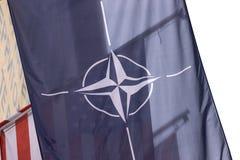 Nato flag in front of an usa flag. A nato flag in front of an usa flag royalty free stock photography