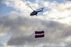 NATO helicopters and airplane with flag at military parade in Riga, Latvia. November 18, 2018. NATO helicopters and airplane with flag at military parade in stock images