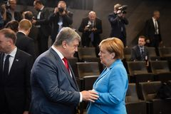 NATO military alliance summit in Brussels. BRUSSELS, BELGIUM - Jul 12, 2018: Ukrainian President Petro Poroshenko and German Chancellor Angela Merkel during NATO royalty free stock photography