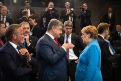 NATO military alliance summit in Brussels. BRUSSELS, BELGIUM - Jul 12, 2018: Ukrainian President Petro Poroshenko and German Chancellor Angela Merkel during NATO stock image