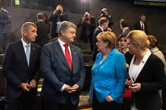 NATO military alliance summit in Brussels. BRUSSELS, BELGIUM - Jul 12, 2018: Ukrainian President Petro Poroshenko and German Chancellor Angela Merkel during NATO stock photos