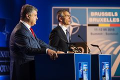 NATO military alliance summit in Brussels. BRUSSELS, BELGIUM - Jul 12, 2018: Ukrainian President Petro Poroshenko and NATO Secretary General Jens Stoltenberg stock photo