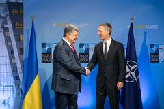 NATO military alliance summit in Brussels. BRUSSELS, BELGIUM - Jul 12, 2018: Ukrainian President Petro Poroshenko and NATO Secretary General Jens Stoltenberg royalty free stock photos
