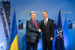 NATO military alliance summit in Brussels. BRUSSELS, BELGIUM - Jul 12, 2018: Ukrainian President Petro Poroshenko and NATO Secretary General Jens Stoltenberg stock photography