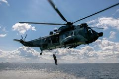 NATO rescue mission in sea with helicopter stock image