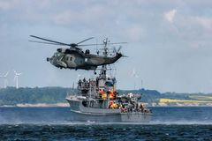NATO rescue mission in sea with ship and helicopter royalty free stock images
