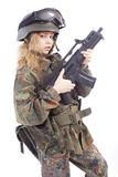 Nato rifle. Shot of a beautiful girl holding gun. Uniform conforms to special services(soldiers) of the NATO countries. Shot in studio. Isolated on white Stock Photos