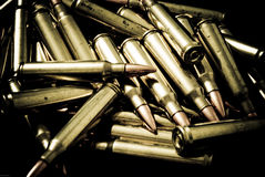 5.56 NATO Rifle Ammunition. Pile of .223/5.56 ammunition used in M16/AR15 type firearms royalty free stock photos
