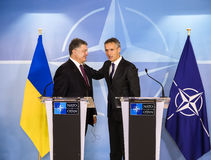 NATO Secretary General Jens Stoltenberg and President of Ukraine. BRUSSELS, BELGIUM - Oct 20, 2016: President of Ukraine Petro Poroshenko during a meeting with royalty free stock photo