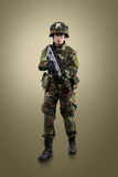 NATO soldier. Military woman over khaki background royalty free stock image