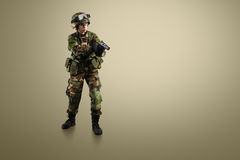 NATO soldier. Military woman over khaki background royalty free stock photography