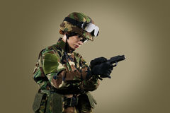NATO soldier. Military woman over khaki background stock photo