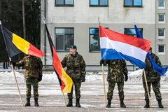 NATO soldiers hold national flags. The North Atlantic Treaty Organization, also called the North Atlantic Alliance, is an intergovernmental military alliance royalty free stock photo
