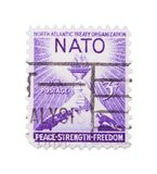 Nato Stamp. Old Nato Postage Stamp Isolated on White Background royalty free stock photography