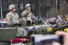 NATO tanks and soldiers at military parade in Riga, Latvia. November 18, 2017. Parade in honor of proclamation of Latvia at November 18 for the Independence Day royalty free stock photography