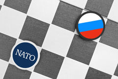 NATO vs Russia. Draughts (Checkers) - NATO vs Russia. Checkers represents conflict between country and organisation Royalty Free Stock Photos