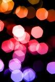 Natt eller festligt partibegrepp: abstrakt bakgrund bl?nker ljusa bokehljus fotografering för bildbyråer