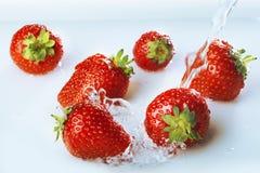Natte aardbeien Stock Foto's