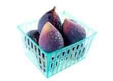 Natte fig. in een mand stock fotografie