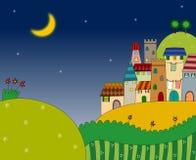 Natten beskådar av staden på kullen Arkivbild