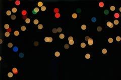 Nattljus - färgbakgrund - cirklar av ljus och skönhet Arkivfoton