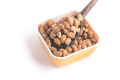 Natto. Fermented soybeans into a spoon. Isolated on white background Royalty Free Stock Photos