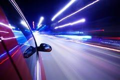 Natttrafik, for från fönstret av rusar bilen Royaltyfri Foto