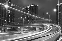 Natttrafik på huvudvägen Royaltyfria Bilder
