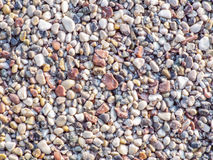 Natual colored stones texture. Background with natural colored stones texture Royalty Free Stock Image