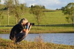 Natur- u. Tierphotograph bei der Arbeit Stockfotografie