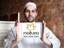 Natura beauty care company logo. Logo of natura beauty care company on samsung tablet holded by arab muslim man stock photos
