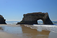 The Natura Bridge ate the Natural Bridges National Park in Santa Cruz. Stock Photos