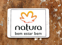 Natura logo. Logo of natura beauty care company on samsung tablet on wooden background stock photos