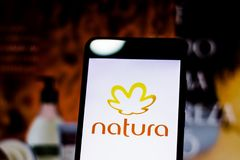 March 10, 2019, Brazil. Natura logo on the mobile device screen. It is a Brazilian company that acts in the sector of treatment. Natura logo on the mobile device royalty free stock photos