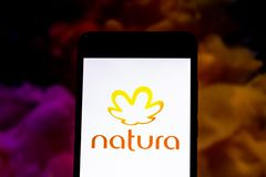 March 10, 2019, Brazil. Natura logo on the mobile device screen. It is a Brazilian company that acts in the sector of treatment. Natura logo on the mobile device stock photography