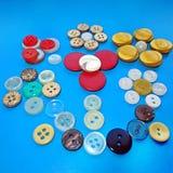 Natura morta con dei colori differenti i bottoni Fotografie Stock