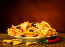Natura morta con i nacho Immagini Stock