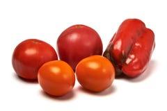 Natura morta con i pomodori gialli e rossi del peperone dolce, Fotografia Stock