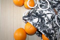 Natura morta con le arance e la borsa Immagine Stock