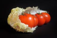 Natura morta con le verdure isolate su un fondo nero Fotografie Stock